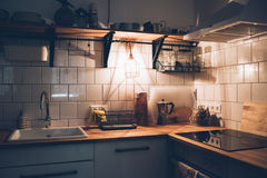Vintage white kitchen interior, cooking objects with warm light. Cozy vintage white kitchen interior, cooking objects with warm light Royalty Free Stock Photography
