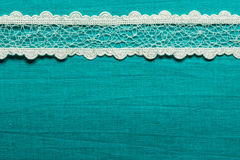 Vintage white lace over blue background royalty free stock images
