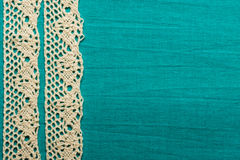 Vintage white lace over blue background stock image