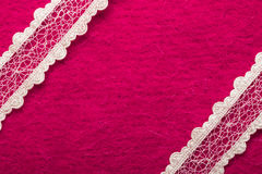 Vintage white lace over pink background Stock Image