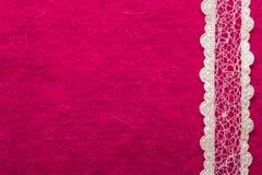 Vintage white lace over pink background. Retro border for invitations celebration. Vintage white lace over pink textile background Royalty Free Stock Photos