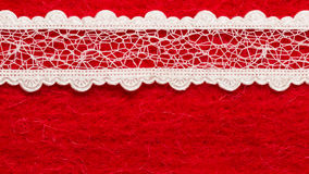 Vintage white lace over red background. Retro border for invitations celebration. Vintage white lace over red textile background royalty free stock photography