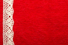 Vintage white lace over red background Stock Photo
