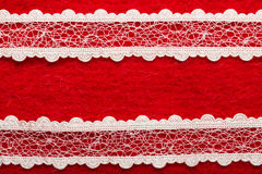 Vintage white lace over red background Stock Photos