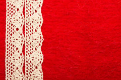 Vintage white lace over red background. Retro border for invitations celebration. Vintage white lace over red textile background stock images