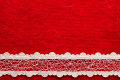 Vintage white lace over red background. Retro border for invitations celebration. Vintage white lace over red textile background stock photo