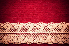 Vintage white lace over red background Royalty Free Stock Images