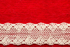 Vintage white lace over red background Stock Images