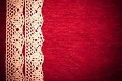 Vintage white lace over red background Royalty Free Stock Photography