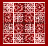 Vintage white lace patterns on red background, filigree repetitive ornamental tile. In old style, geometric symmetric motif, vector EPS 10 Royalty Free Stock Photography