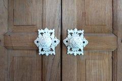 Vintage white paint furniture door knobs. Elevation of the Vintage white paint furniture door knobs on rustic timber door Stock Image