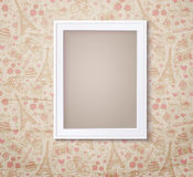 Vintage white photoframe on french fashioned wallpaper Royalty Free Stock Photo