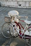 Vintage White and Red Bicycles in Love. Two vintage, retro bicycles in old town. White is for the female and red is for the male. It is easy to think that their Stock Photography