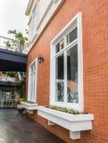 Vintage white window frame on orange brick wall Royalty Free Stock Photos