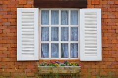 Vintage white window on red brick wall.  royalty free stock photo