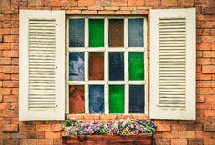 Vintage white window on red brick wall Royalty Free Stock Photo