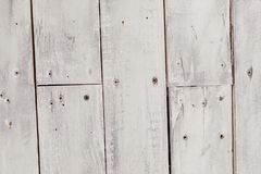 Vintage white wooden background with nails royalty free stock image