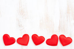 Vintage white wooden background with red hearts Stock Images
