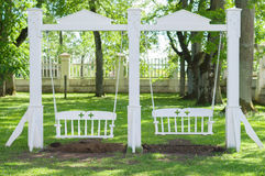 22f5bd1fad Vintage white wooden swing in the garden. Vintage white wooden swing in the  sunny garden