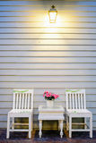 Vintage white wooden wall and chair Royalty Free Stock Photography