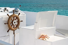 Vintage white yacht. White yacht with wodden steering wheel in the calm sea Royalty Free Stock Photography