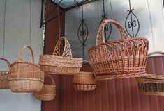 Vintage wicker baskets hanging on the market Royalty Free Stock Photo