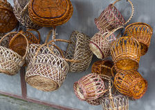 Vintage wicker baskets hanging on the market Royalty Free Stock Image