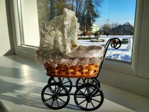 A vintage wicker toy baby carriage. royalty free stock images