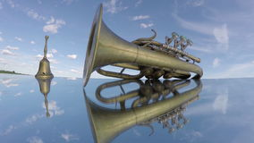 Vintage wind musical instrument and brass  bell on mirror. Timelapse 4K stock video footage