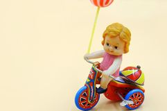 Vintage Wind Up Kids Riding Tricycle stock images