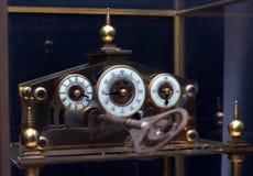 Vintage winding clock Stock Photos