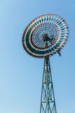 Wind mill. Vintage windmill against blue sky in Thailand Stock Photos