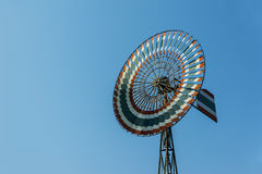 Wind mill. Vintage windmill against blue sky in Thailand royalty free stock photos