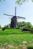 Vintage Windmill near Lake, Netherlands Stock Photos