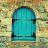 Vintage window with blue close shutters, Crete, Greece. royalty free stock photography