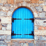 Vintage window with blue close shutters, Crete, Greece. Royalty Free Stock Photo