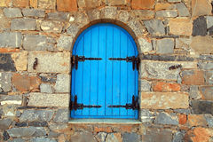 Vintage window with blue shutters,Greece. Royalty Free Stock Photography