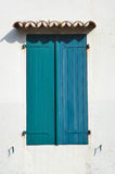 Vintage window with closed shutters Stock Photo