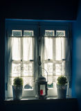 Vintage Window and Curtain with Flower Pots and Old Lamp Royalty Free Stock Photo