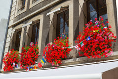 Vintage window with flowers and flags, Geneva, Switzerland Royalty Free Stock Photos