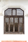 Vintage window in front of building Royalty Free Stock Images