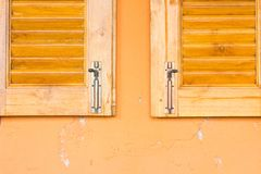 Vintage window latch on a classic timber window panel Royalty Free Stock Image