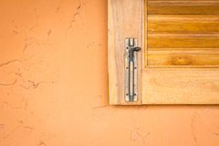 Vintage window latch on a classic timber window panel Stock Image