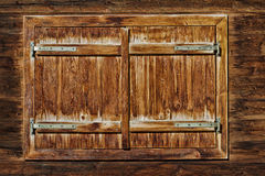 Vintage Window of old alpine hut. Wooden rustic background Royalty Free Stock Photography