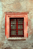 Vintage window on old dirty damaged wall Royalty Free Stock Image