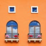 Vintage window on orange cement wall. Royalty Free Stock Image