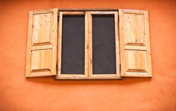 Vintage window on orange wall Stock Images