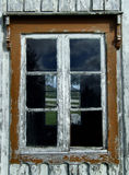 Vintage window with peeling paint. Old window in a historic wooden building in Norway. Scandinavian architecture Stock Image