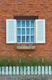 Vintage window on red brick wall Stock Photography