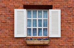 Vintage window on red brick wall Stock Photos
